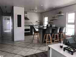 Quay West Holiday Home - Interior - open plan kitchen/dining/lounge