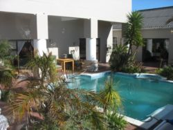 Tranquil swimming pool area with braai facilities