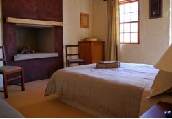 Red Rock Cottage - The first of two en suite bedrooms with it's own fireplace and private patio