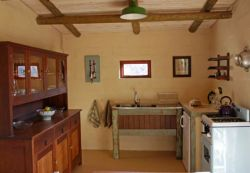 Red Rock Cottage - The kitchen area in the open plan living space