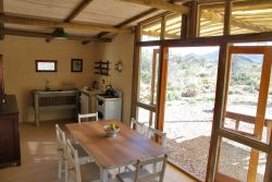 Red Rock Cottage - The kitchen and dining area in the open plan living space