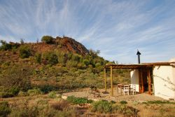 Red Rock Cottage - exterior with Red Rock in the background