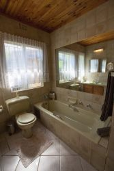 En-suite bathroom with Toilet,bath,shower and wash basin.