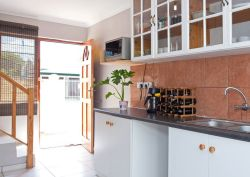 Entrance to fully equipped kitchen. Pictured is large microwave oven, coffee machine and wine rack. Out of sight is the toaster, kettle and other equipment
