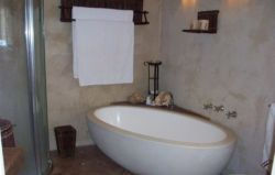 This is main bedroom's bathroom en-suite with stone bath, sep shower, bidet, toilet & stone hand basin.