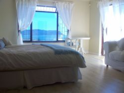 Main Bedroom (king bed) & single day bed - with sea views & French doors to patio.