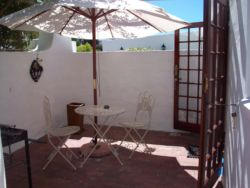 Pretty private courtyard of Studio with French Doors to cosy accommodation.