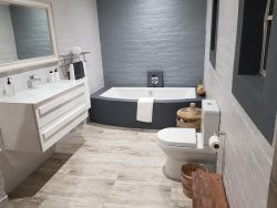 En suite bathroom, all fitted with separate bath and shower.
