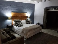 Bedroom Kudu: King sized XL bed in a large room with en suite bathroom.