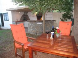 Teak-wood furniture with bar and entertainment area - pizza oven and bbq/braai