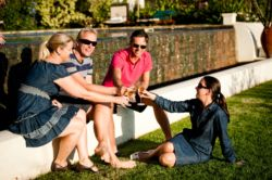 Socialise with friends and feast with a glass of wine at the pool