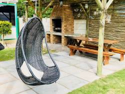 Swing chair at braai area outside