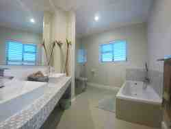 En-suite of second bedroom, with bath tub and shower