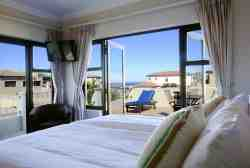 2nd bedroom upstairs (king-size bed or 2 singles), TV, DSTV, balcony, sun-lounger, table, en-suite