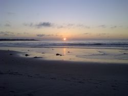 Spectacular beach sunsets are only a 5-minute walk from SeaBreak Cottage!