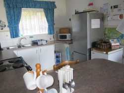 Kitchen with 4 plate stove & oven, fridge/freezer, microwave and separate freezer