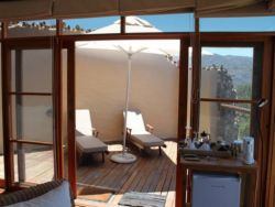 Each chalet has a deck and balcony with deckchairs and an outside shower, completely private.