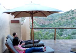 Guests enjoying their private deck outside, looking down into the gorge below.