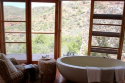 Each chalet has a bath with a wonderful view of the gorge below, and candles.