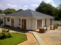 Overview of guest rooms with a garden view and indoor solar heated swimming pool.