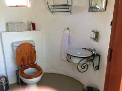 Hornbill Bush Bathroom - Covered toilet & Basin with outside shower.