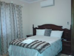 Spacious furnished room with Air conditioner, DSTV, internet Access (Wi-Fi) and tea/coffee table. Room comes with a Double bed.