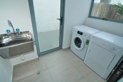 Shared laundry with washing machine, tumble dryer and accessible washing line