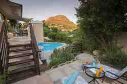 Pool and mountain view from private terrace of self catering suite