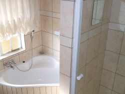 Bathroom with corner bath and shower