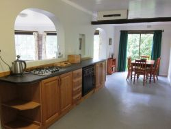 Kitchen has a gas hob, electric oven and a wood stove. Fridge/freezer, toaster, kettle and microwave