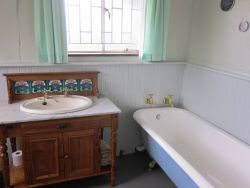Olde worlde bathroom with ball and claw bath and spacious shower