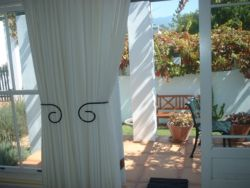 We have only two studios. The smaller one has french doors opening out onto a vine-covered patio