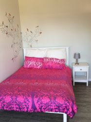 Unit B Double bed bedroom