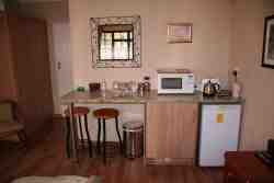 Kitchenette with small fridge and microwave