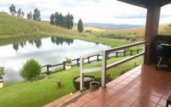 Protea Cottage patio looking out onto private dam