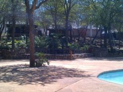 Pool/Braai area near Rustic Wooden Cabins and ablutions