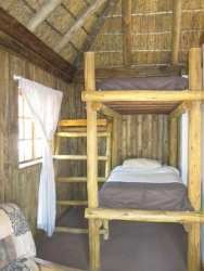 Self Catering Chalet with bunk beds in open plan lounge area/kitchenette
