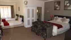Room 1: Family room with a queen size double bed and 2 single beds. Full en-suite bathroom.