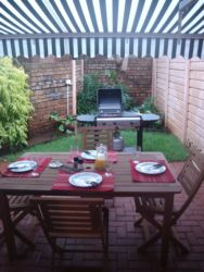 Patio with furniture and gas bbq