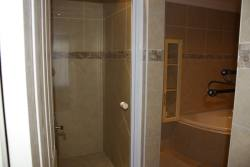 Bathroom (shower, corner bath, wash basin and toilet