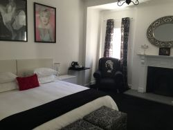 Marilyn Monroe Room - King size Bed. All Rooms have bathrooms.