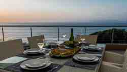 A sunset dinner for six people on the balcony