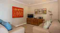 Separate TV alcove with flat screen TV, DSTV and DVD player
