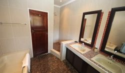 King Suite Bathroom with double basins walk in shower and full size bath