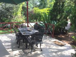 Our Patio by the Pool, perfect place to relax, have breakfast, or just take in the nature of our lush garden.