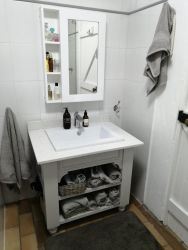 The bathroom has a shower, bath, basin and toilet and towels and toiletries are provided