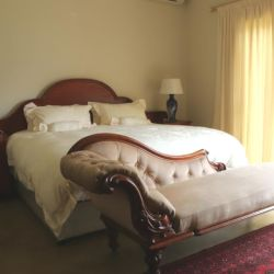 The Deluxe King Room on ground level of the establishment.