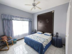 Second Bedroom features air-conditioning and a ceiling fan and shares a bathroom with the thrid bedroom