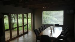 10 seater dining table and build in braai. Folding sliding doors open up onto the garden. Unit 5 Treelands Estate