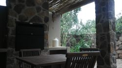 Unit 1  - Private patio with 4 seater table and build-in braai.